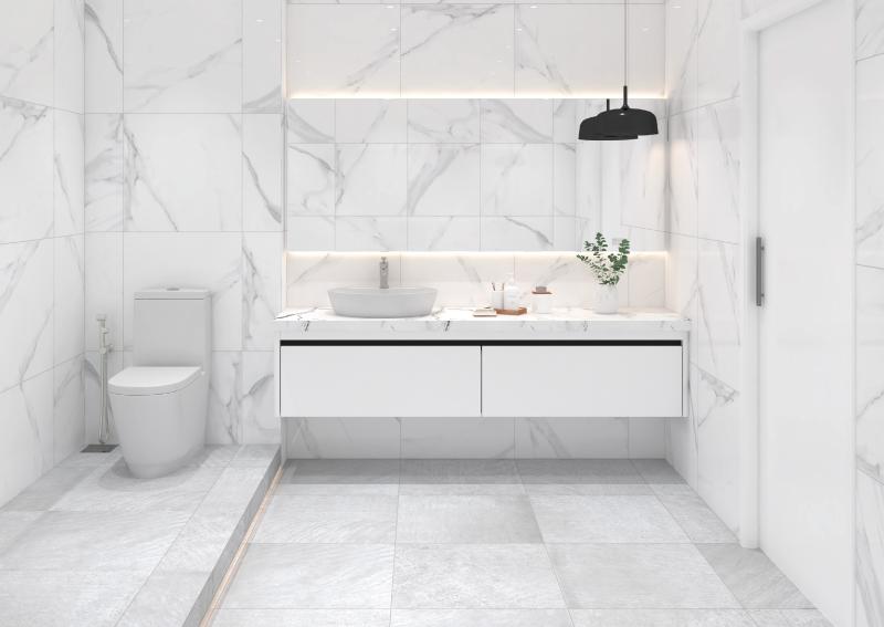 A bathroom with light colour tiles